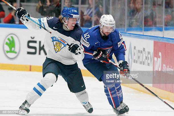 Patrik Laine of Finland in action with Julien Desrosiers of France during the 2016 IIHF World Championship between France and Finland at Yubileyny...