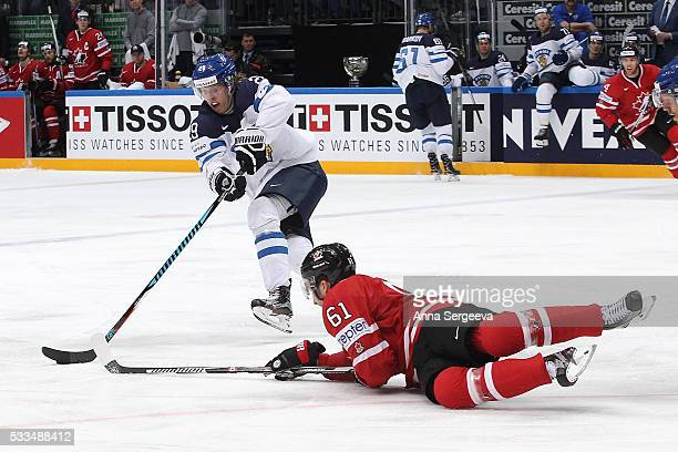 Patrik Laine of Finland plays the puck against Mark Stone of Canada during the 2016 IIHF World Championship gold medal game at the Ice Palace on May...