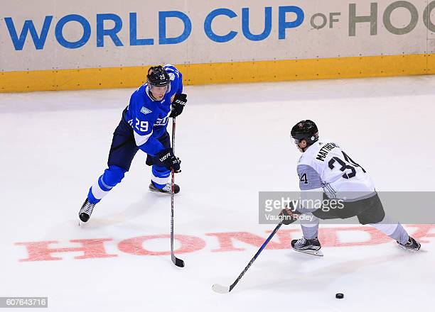 Patrik Laine of Team Finland passes the puck past Auston Matthews of Team North America during a World Cup of Hockey 2016 game at Air Canada Centre...