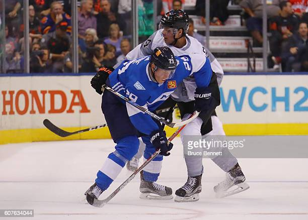 Patrik Laine of Team Finland skates against Auston Matthews of Team North America during the World Cup of Hockey tournament at the Air Canada Centre...