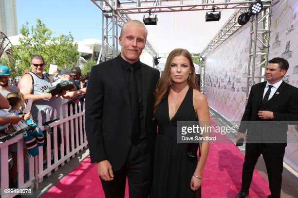 Patrik Laine of the Winnipeg Jets and guest arrive on the magenta carpet for the 2017 NHL Awards at TMobile Arena on June 21 2017 in Las Vegas Nevada