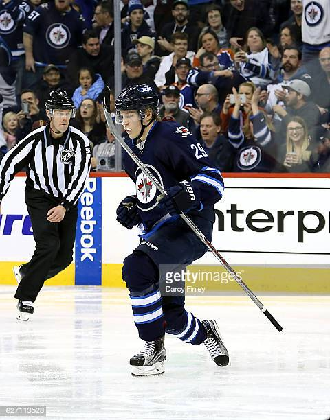 Patrik Laine of the Winnipeg Jets celebrates after scoring his second goal of the night during third period action against the Edmonton Oilers at the...
