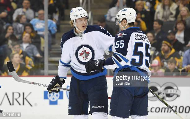 Patrik Laine of the Winnipeg Jets celebrates his goal with Mark Scheifele in the second period during the game against the Pittsburgh Penguins at PPG...