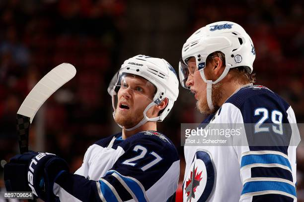 Patrik Laine of the Winnipeg Jets chats with teammate Nikolaj Ehlers during a break in the action against the Florida Panthers at the BBT Center on...