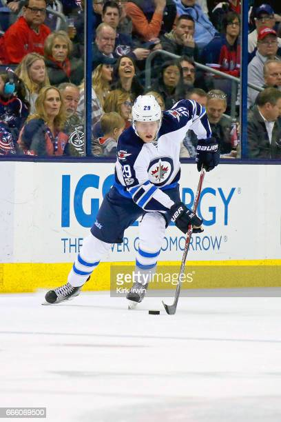 Patrik Laine of the Winnipeg Jets controls the puck during the game against the Columbus Blue Jackets on April 6 2017 at Nationwide Arena in Columbus...