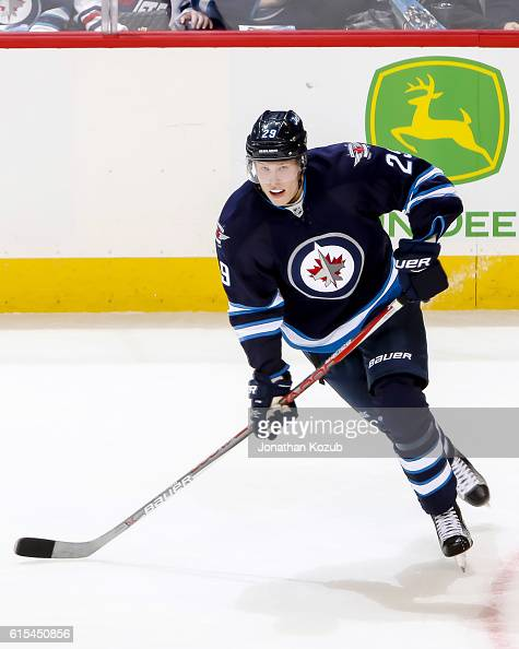 Patrik Laine of the Winnipeg Jets follows the play down the ice during second period action against the Carolina Hurricanes at the MTS Centre on...