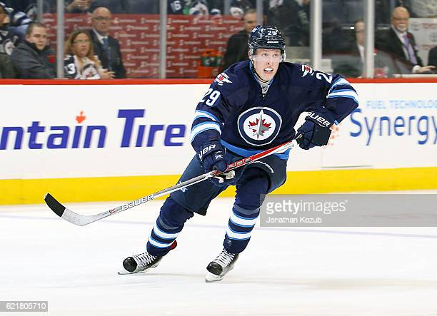 Patrik Laine of the Winnipeg Jets follows the play down the ice during second period action against the Dallas Stars at the MTS Centre on November 8...