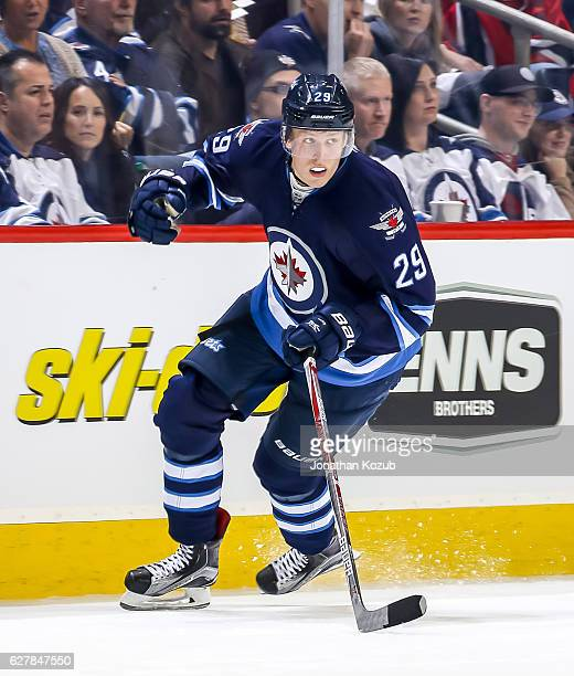 Patrik Laine of the Winnipeg Jets follows the play down the ice during second period action against the New Jersey Devils at the MTS Centre on...