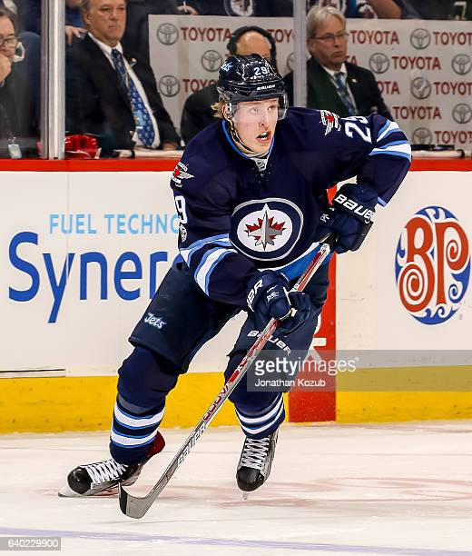 Patrik Laine of the Winnipeg Jets follows the play down the ice during second period action against the San Jose Sharks at the MTS Centre on January...