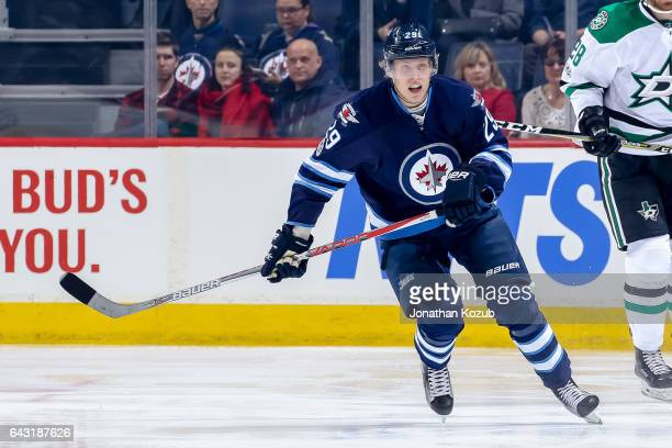 Patrik Laine of the Winnipeg Jets follows the play down the ice during first period action against the Dallas Stars at the MTS Centre on February 14...
