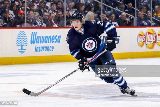 Patrik Laine of the Winnipeg Jets follows the play down the ice during second period action against the Pittsburgh Penguins at the MTS Centre on...