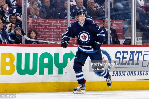 Patrik Laine of the Winnipeg Jets follows the play down the ice during second period action against the Philadelphia Flyers at the MTS Centre on...
