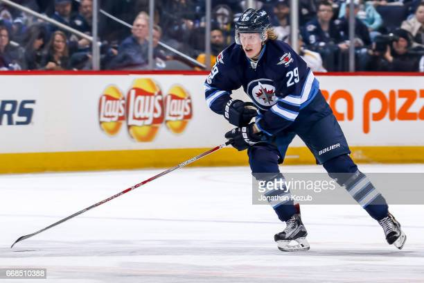 Patrik Laine of the Winnipeg Jets follows the play down the ice during second period action against the Nashville Predators at the MTS Centre on...