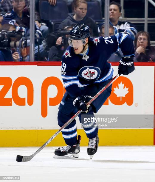Patrik Laine of the Winnipeg Jets follows the play down the ice during third period action against the Toronto Maple Leafs at the Bell MTS Place on...