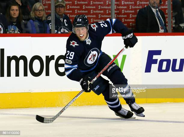 Patrik Laine of the Winnipeg Jets follows the play down the ice during second period action against the Carolina Hurricanes at the Bell MTS Place on...