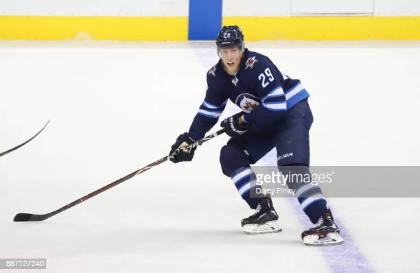 Patrik Laine of the Winnipeg Jets follows the play down the ice during second period action against the Vegas Golden Knights at the Bell MTS Place on...
