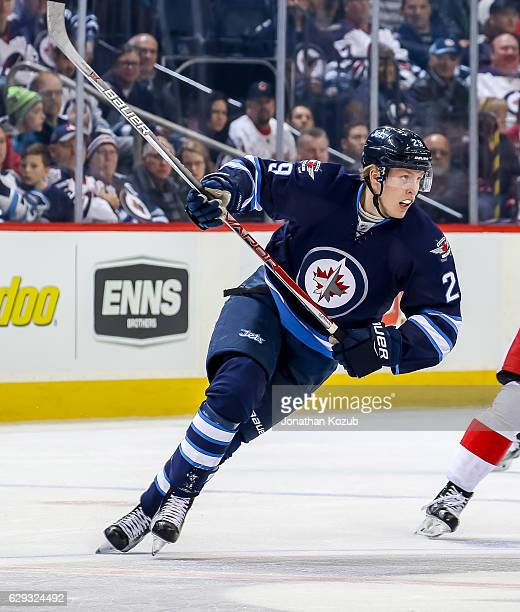 Patrik Laine of the Winnipeg Jets follows the play up the ice during first period action against the Detroit Red Wings at the MTS Centre on December...