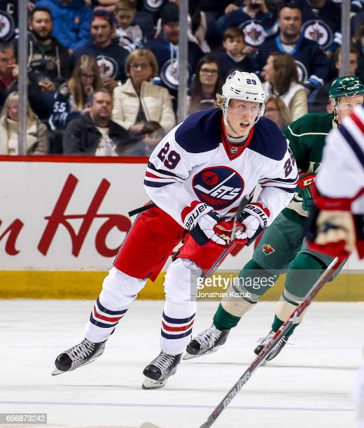 Patrik Laine of the Winnipeg Jets follows the play up the ice during first period action against the Minnesota Wild at the MTS Centre on March 19...