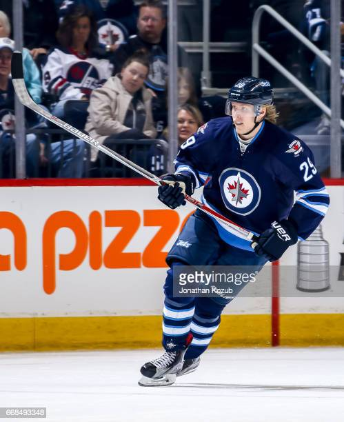 Patrik Laine of the Winnipeg Jets follows the play up the ice during first period action against the Nashville Predators at the MTS Centre on April 8...