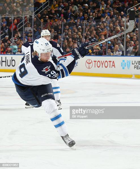Patrik Laine of the Winnipeg Jets follows through on a shot against the Buffalo Sabres during the second period of an NHL game at the KeyBank Center...