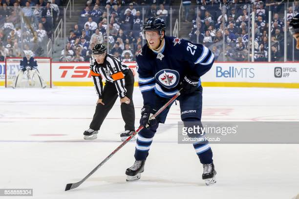 Patrik Laine of the Winnipeg Jets gets set during a first period faceoff against the Toronto Maple Leafs at the Bell MTS Place on October 4 2017 in...