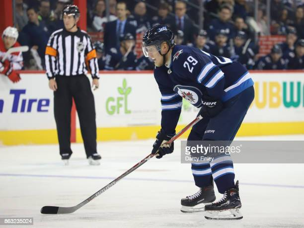 Patrik Laine of the Winnipeg Jets gets set during a first period faceoff against the Carolina Hurricanes at the Bell MTS Place on October 14 2017 in...