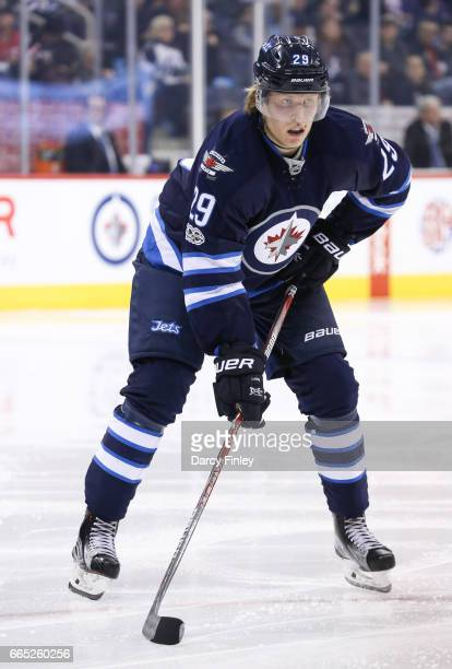 Patrik Laine of the Winnipeg Jets gets set during a second period faceoff against the Ottawa Senators at the MTS Centre on April 1 2017 in Winnipeg...
