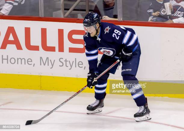 Patrik Laine of the Winnipeg Jets gets set during a third period faceoff against the Carolina Hurricanes at the Bell MTS Place on October 14 2017 in...