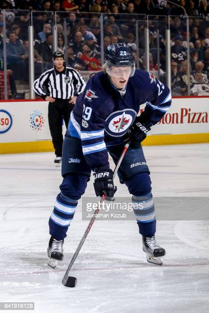 Patrik Laine of the Winnipeg Jets gets set for a second period faceoff against the Chicago Blackhawks at the MTS Centre on February 10 2017 in...