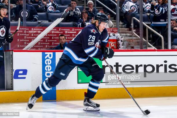 Patrik Laine of the Winnipeg Jets hits the ice prior to puck drop against the Philadelphia Flyers at the MTS Centre on March 21 2017 in Winnipeg...