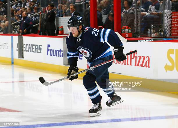 Patrik Laine of the Winnipeg Jets hits the ice prior to puck drop against the Columbus Blue Jackets at the Bell MTS Place on October 17 2017 in...