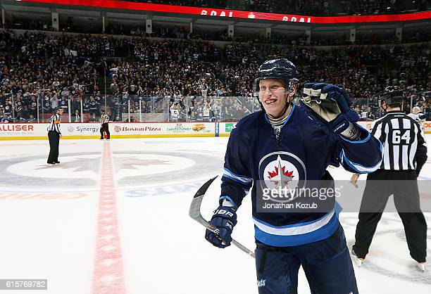 Patrik Laine of the Winnipeg Jets is all smiles as he skates to the bench after scoring a third period goal against the Toronto Maple Leafs at the...