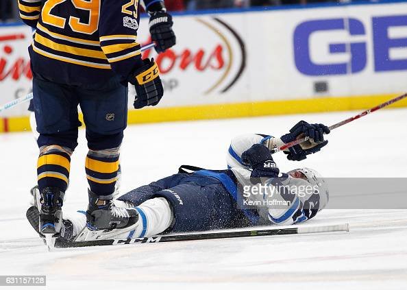 Patrik Laine of the Winnipeg Jets is knocked out after a check by Jake McCabe of the Buffalo Sabres during the third period at the KeyBank Center on...