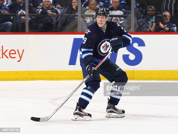 Patrik Laine of the Winnipeg Jets keeps an eye on the play during second period action against the New York Islanders at the MTS Centre on December...