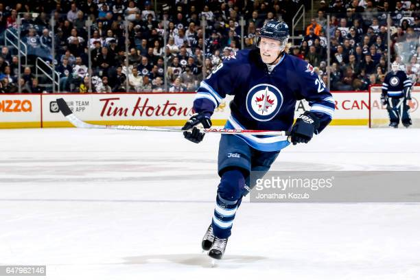 Patrik Laine of the Winnipeg Jets keeps an eye on the play during second period action against the Minnesota Wild at the MTS Centre on February 28...