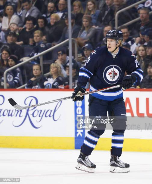 Patrik Laine of the Winnipeg Jets keeps an eye on the play during third period action against the Calgary Flames at the MTS Centre on March 11 2017...