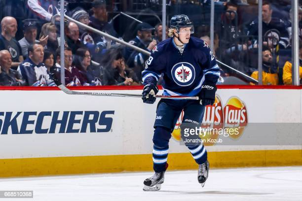 Patrik Laine of the Winnipeg Jets keeps an eye on the play during second period action against the Nashville Predators at the MTS Centre on April 8...