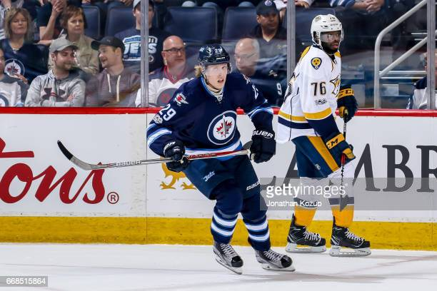 Patrik Laine of the Winnipeg Jets keeps an eye on the play during third period action against the Nashville Predators at the MTS Centre on April 8...