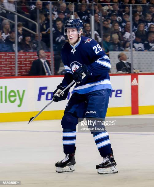 Patrik Laine of the Winnipeg Jets keeps an eye on the play during first period action against the Carolina Hurricanes at the Bell MTS Place on...