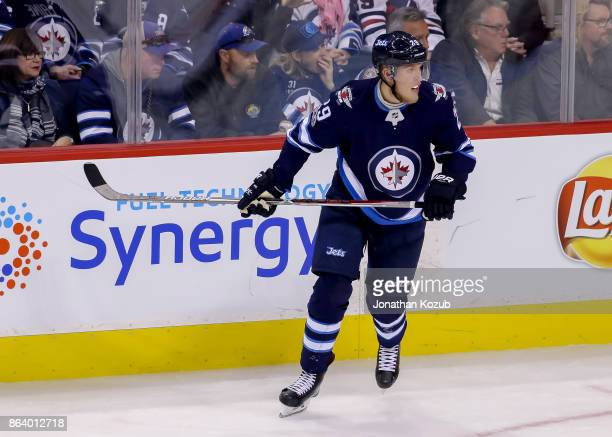 Patrik Laine of the Winnipeg Jets keeps an eye on the play during third period action against the Carolina Hurricanes at the Bell MTS Place on...