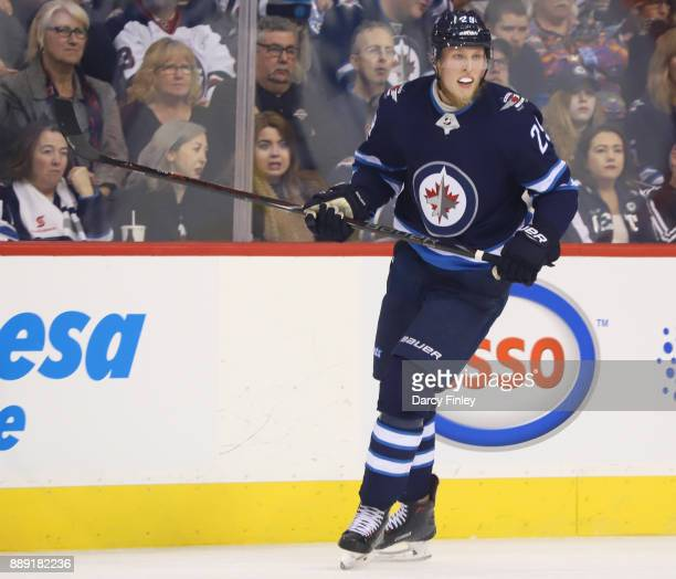 Patrik Laine of the Winnipeg Jets keeps an eye on the play during first period action against the Ottawa Senators at the Bell MTS Place on December 3...