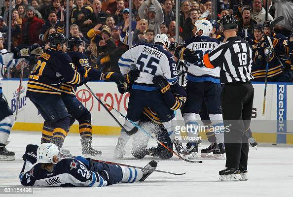 Patrik Laine of the Winnipeg Jets lies on the ice injured after a third period check by the Buffalo Sabres during an NHL game at the KeyBank Center...