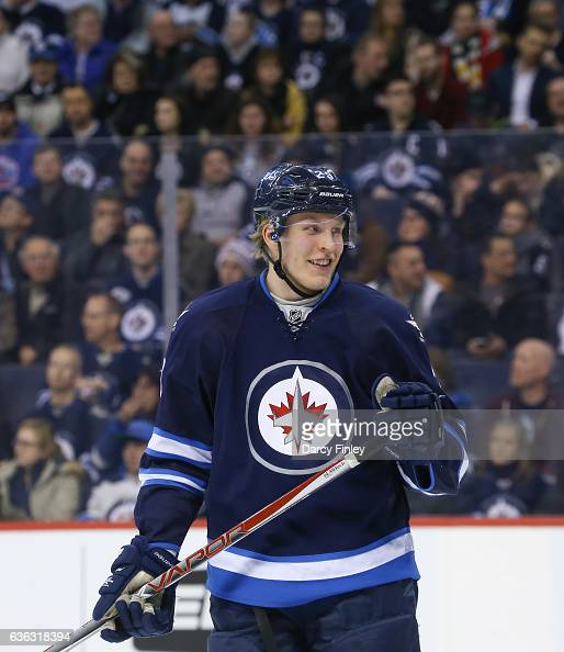 Patrik Laine of the Winnipeg Jets looks on during a third period stoppage in play against the Florida Panthers at the MTS Centre on December 15 2016...
