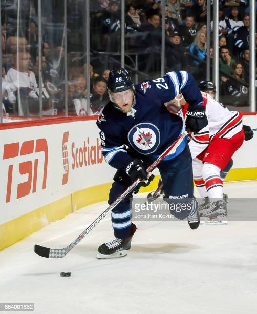 Patrik Laine of the Winnipeg Jets plays the puck along the boards during second period action against the Carolina Hurricanes at the Bell MTS Place...
