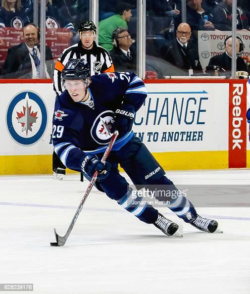 Patrik Laine of the Winnipeg Jets plays the puck down the ice during second period action against the Edmonton Oilers at the MTS Centre on December 1...