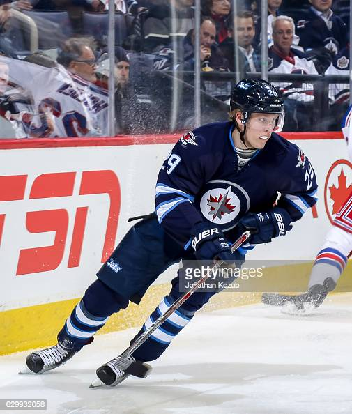 Patrik Laine of the Winnipeg Jets plays the puck down the ice during second period action against the New York Rangers at the MTS Centre on December...