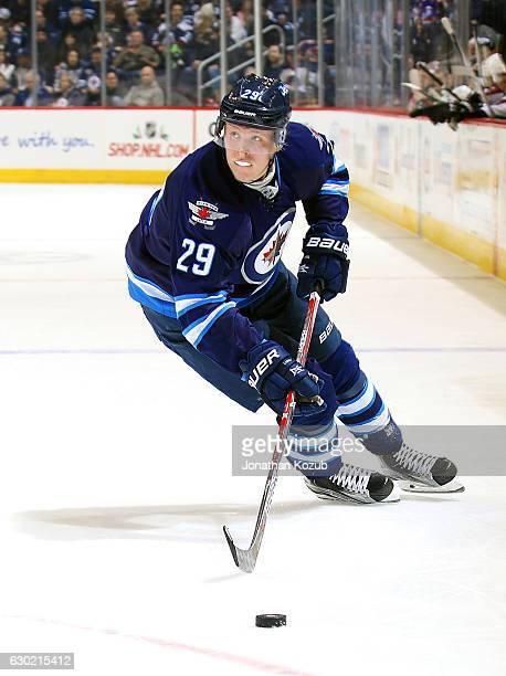 Patrik Laine of the Winnipeg Jets plays the puck down the ice during second period action against the Colorado Avalanche at the MTS Centre on...