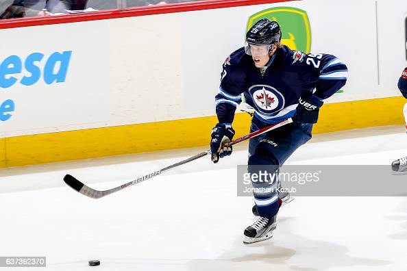 Patrik Laine of the Winnipeg Jets plays the puck down the ice during third period action against the Columbus Blue Jackets at the MTS Centre on...