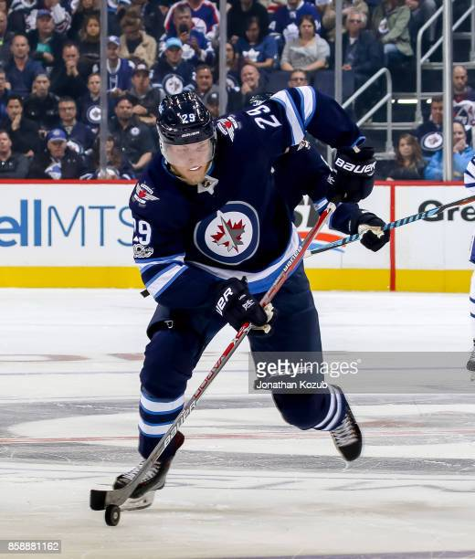 Patrik Laine of the Winnipeg Jets plays the puck down the ice during second period action against the Toronto Maple Leafs at the Bell MTS Place on...