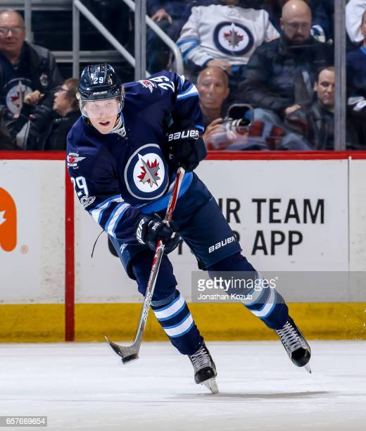 Patrik Laine of the Winnipeg Jets plays the puck up the ice during second period action against the Philadelphia Flyers at the MTS Centre on March 21...